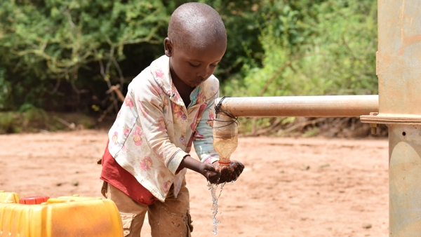 young boyfrom woni witu slef-help group collecting water